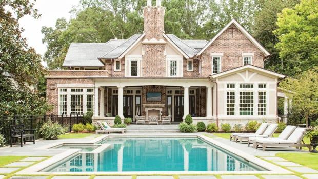 exterior Tudor with pool