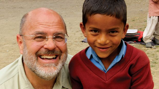 Robert A. Baird (left), the recipient of the sixth annual Clem Labine Award. Baird is pictured here with Latesh, a young boy in India who received extensive cleft lip and palate surgery that was funded by the students of Youth Making a Difference, an organization founded by Baird. Photo: courtesy of Youth Making a Difference