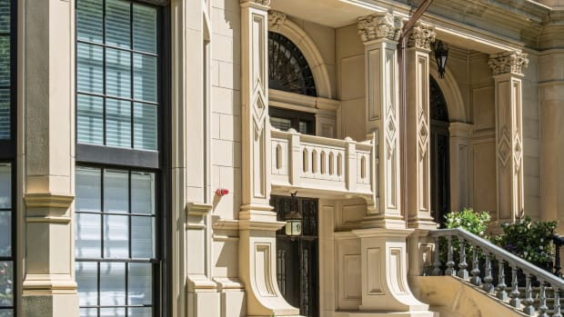 Elongated windows give the illusion of fewer floors. Cornices and horizontal banding combined with other architectural details from 7 Commonwealth visually connect the two buildings.