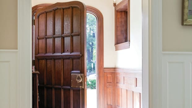The Tudor-style door echoes the trim on the entryway.