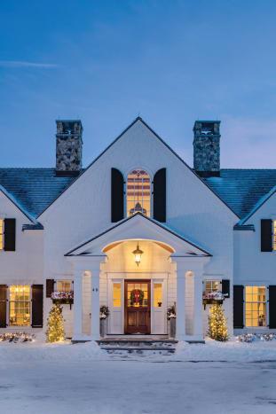 Symmetry creates a strong facade for this Revival house.