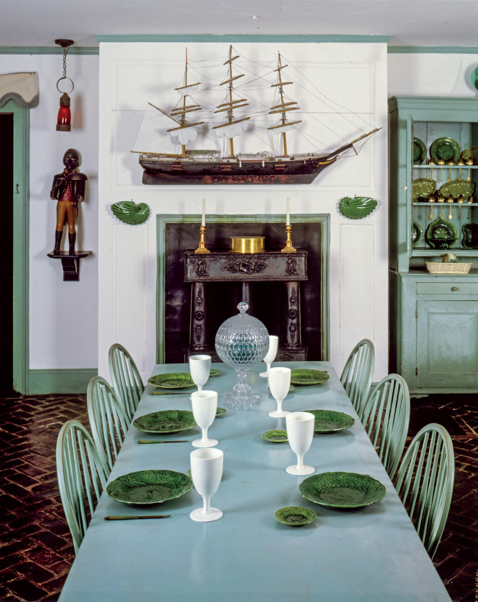 A romantic ode to the sea captains and sailors of the past, the room is a combination of architectural fragments, such as the fine late 18th- century door from Newport, RI, and the variety of nautical instruments displayed on the table.