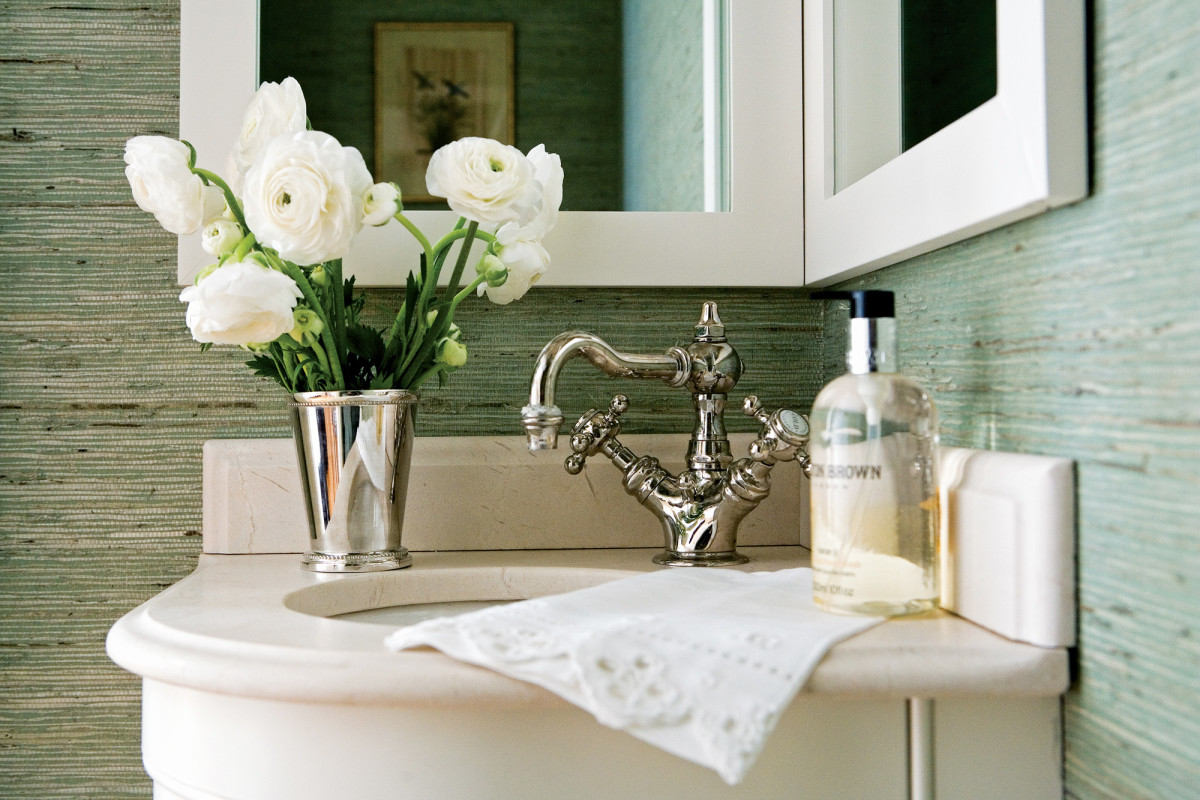 Most period inspired baths have fixtures reproduced to mimic the look of the 1910s or 20s. Photos by Eric Roth