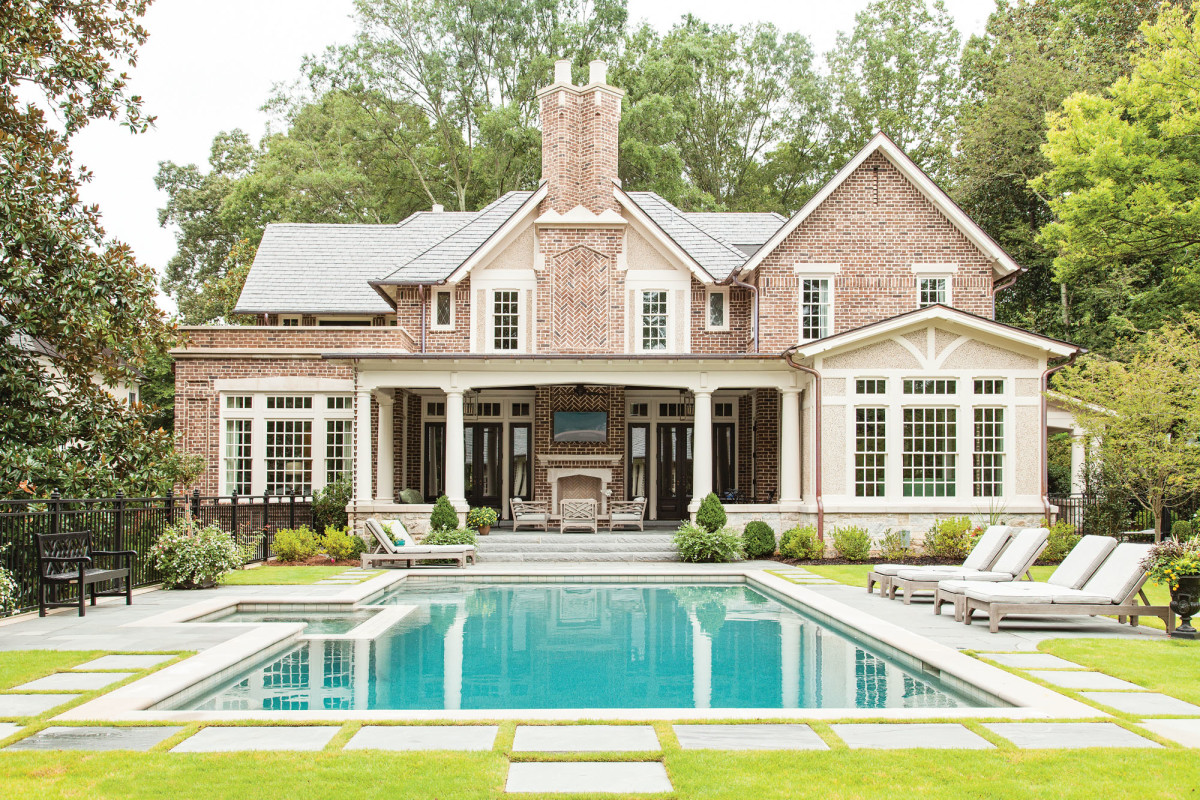 exterior Tudor with pool