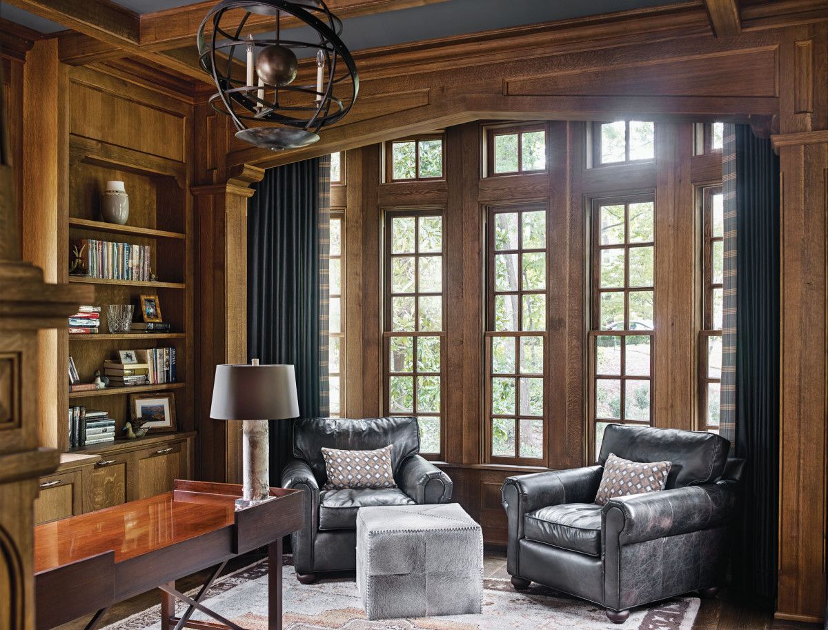 leather chairs, built-in bookshelves, library