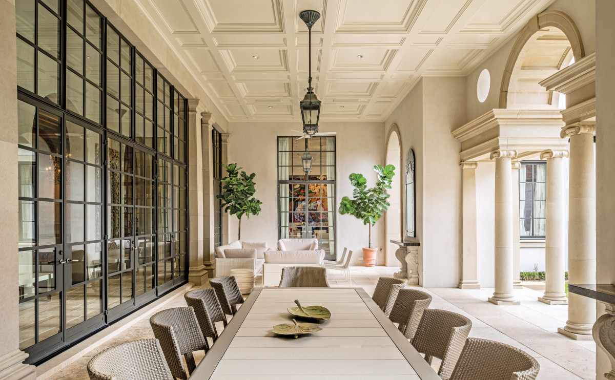 The rear loggia designed for large gatherings as well as intimate family gatherings, features steel doors that lead to the interior of the villa.