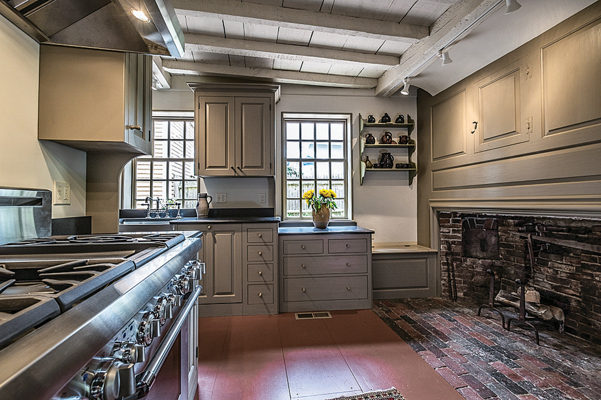 This 18th-century styled kitchen's cabinets were designed and built by Kennebec Cabinetry.