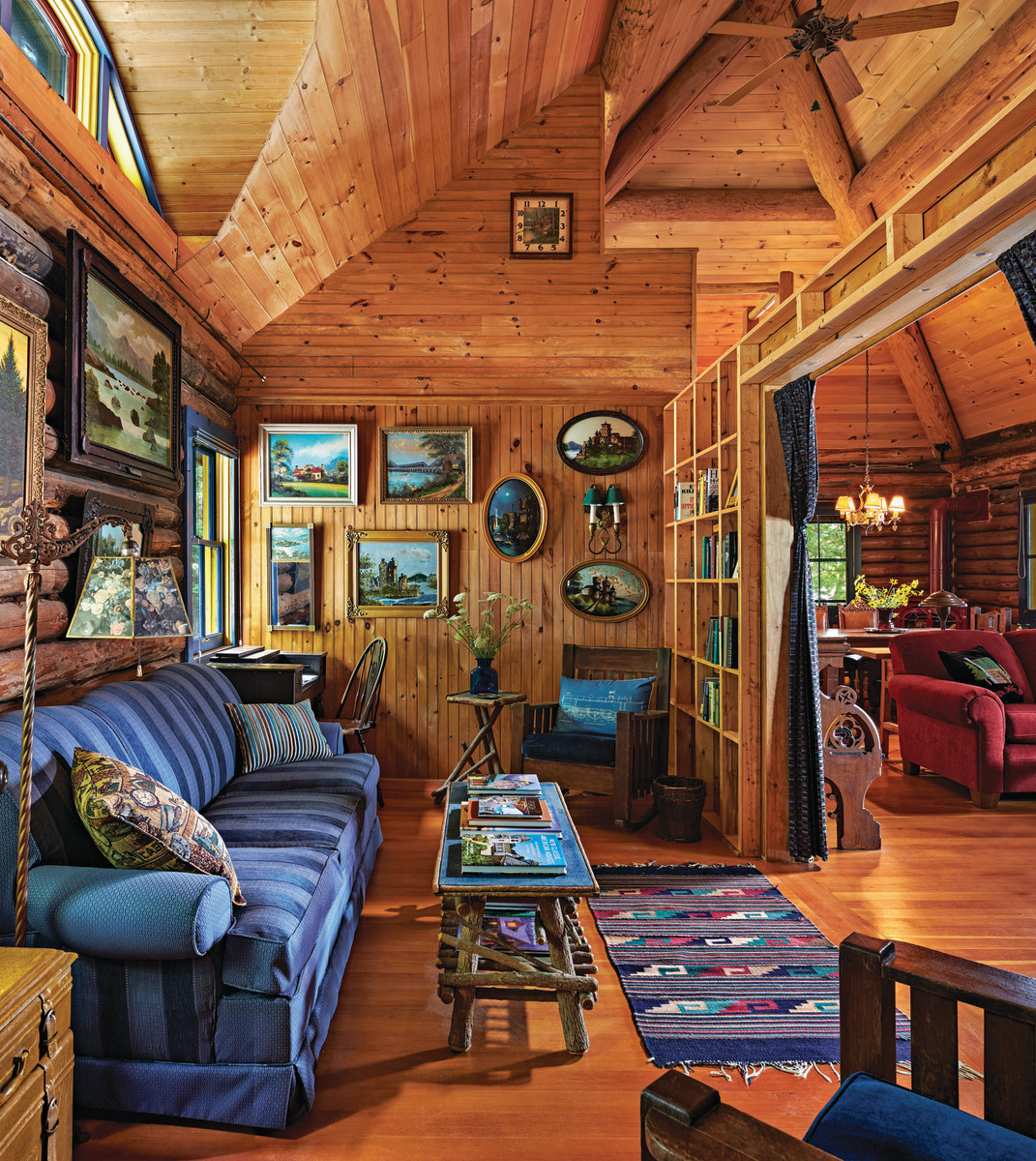 The cabin's original and only bedroom was converted into a library whose book shelves are the studs of the wall.