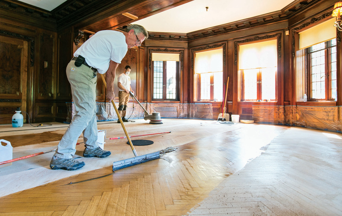 Conservators from Atlanta, Georgia-based Rosebud Company are working to restore the estate's more than 13,740 square feet of aged oak floors using a passive refinishing process.