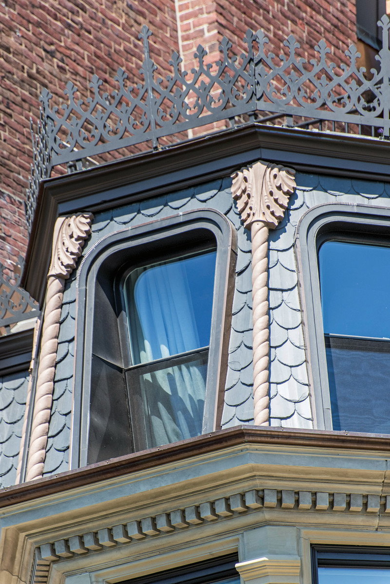 Balancing budget and design intent were achieved by utilizing cast resin to create the ornamental braided roping on the restored mansard roof. The buildings are further unified with a crown of intricately detailed wrought iron.