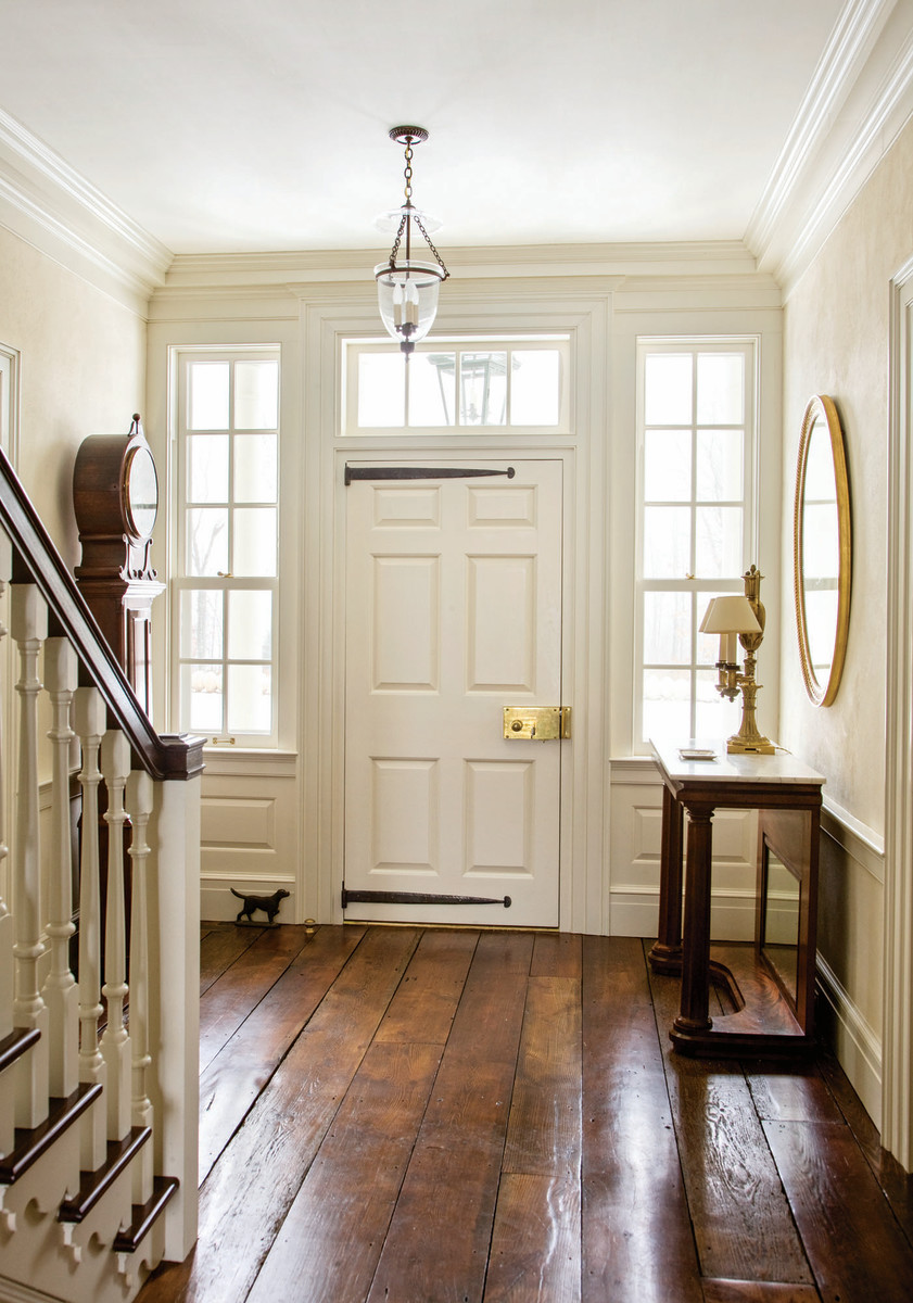 G.P. Schafer Architect designs this Federal entry for a country house in New York. Note the brass hardware and strap hinges.
