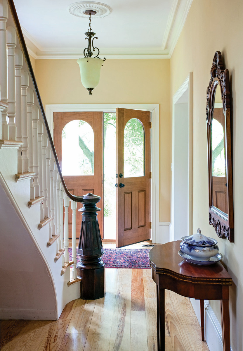 This double door with arched glass window is a hallmark of the Victorian-era style.