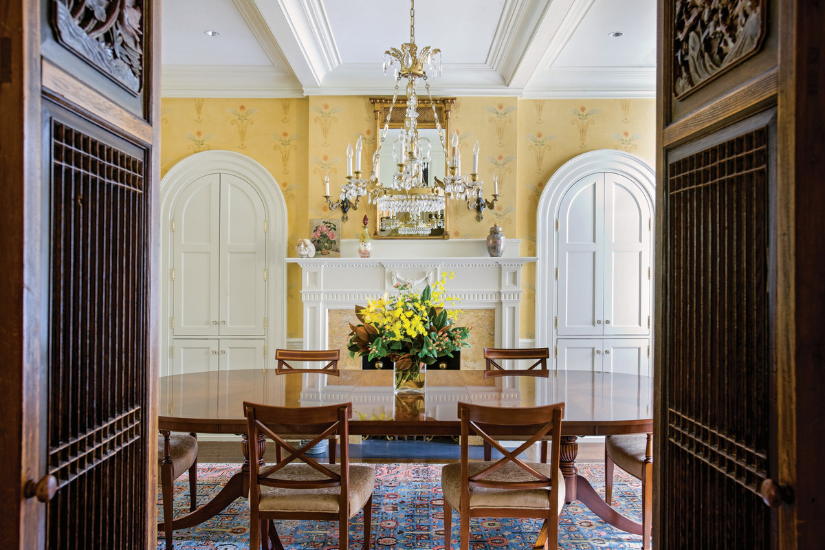 Federal style dining room with built-in cupboards