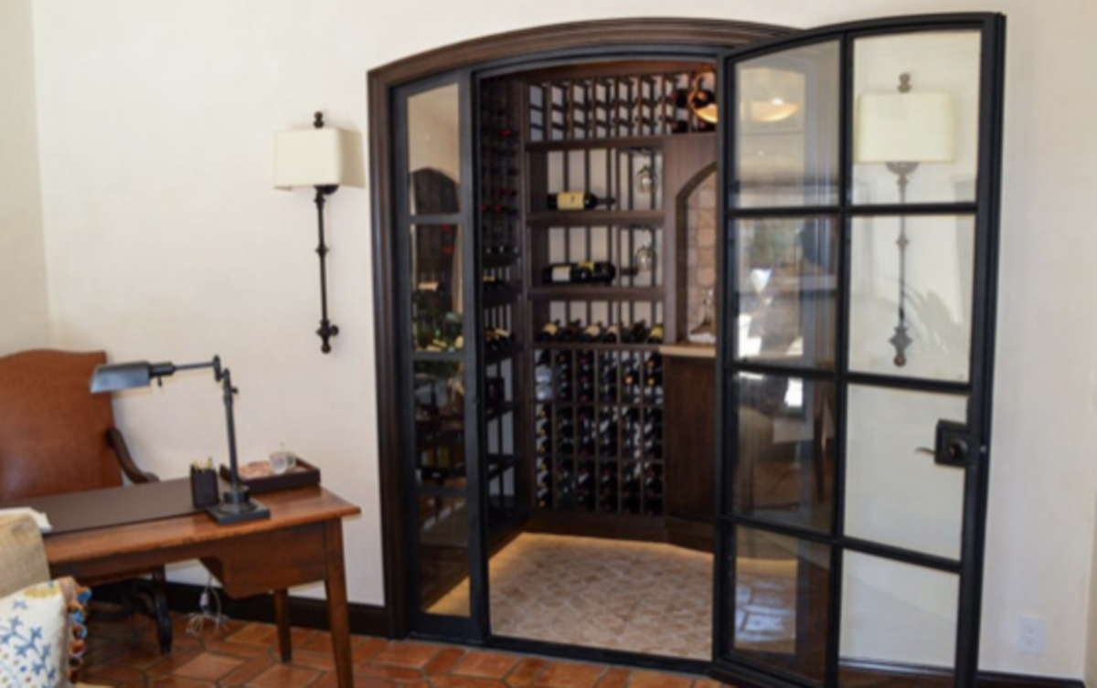 This wine room, created from Vintage Cellars, is the showcase of the home.