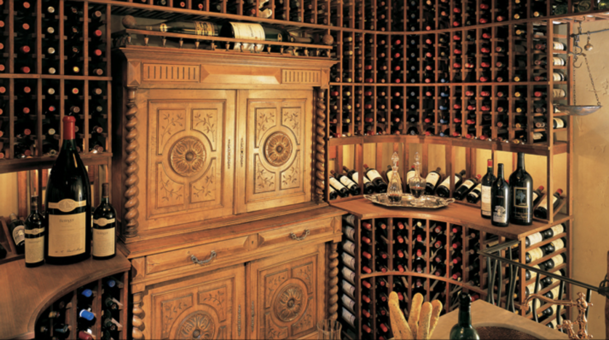 Traditionally styled wine cellar with cabinets