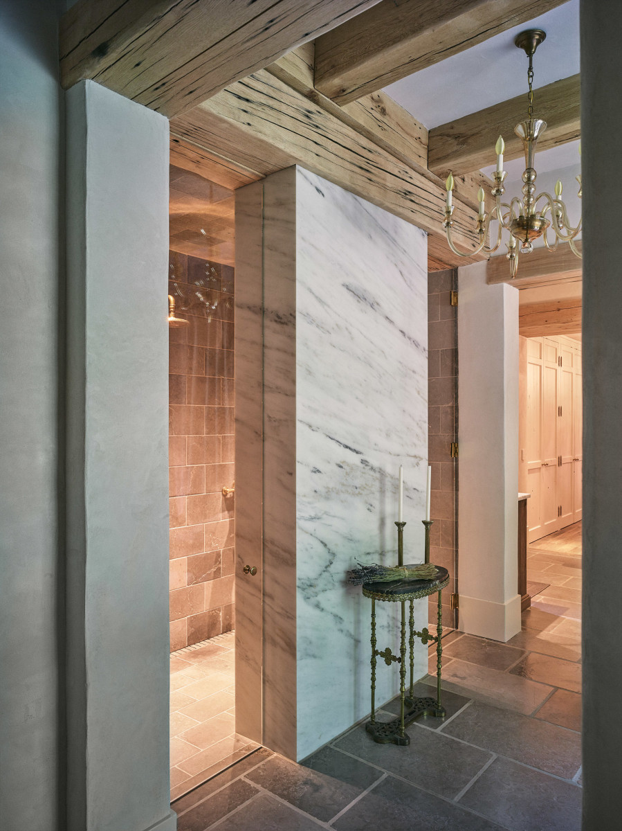 The master bathroom shower, which is made of limestone and Carrara marble, is an example of the home's chic simplicity.
