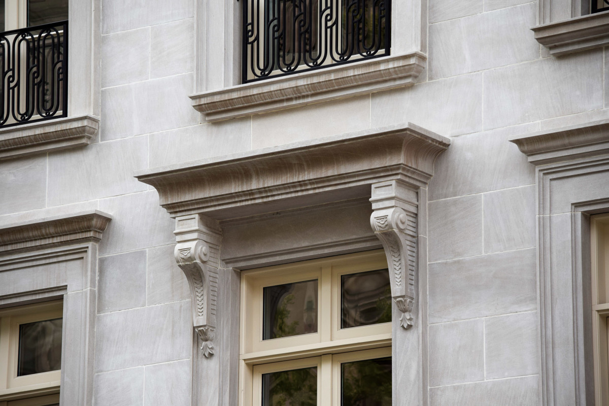 classical stonework of townhome