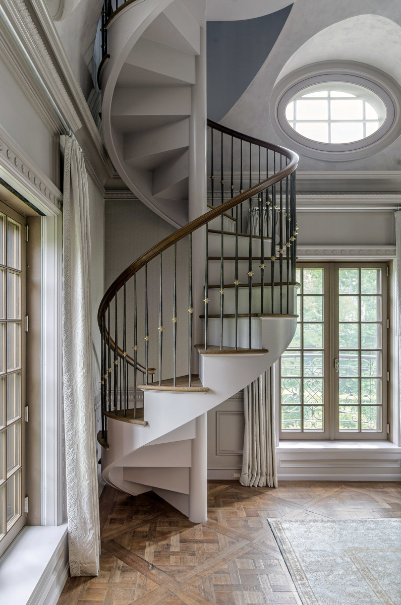 spiral staircase with iron and nickel balusters
