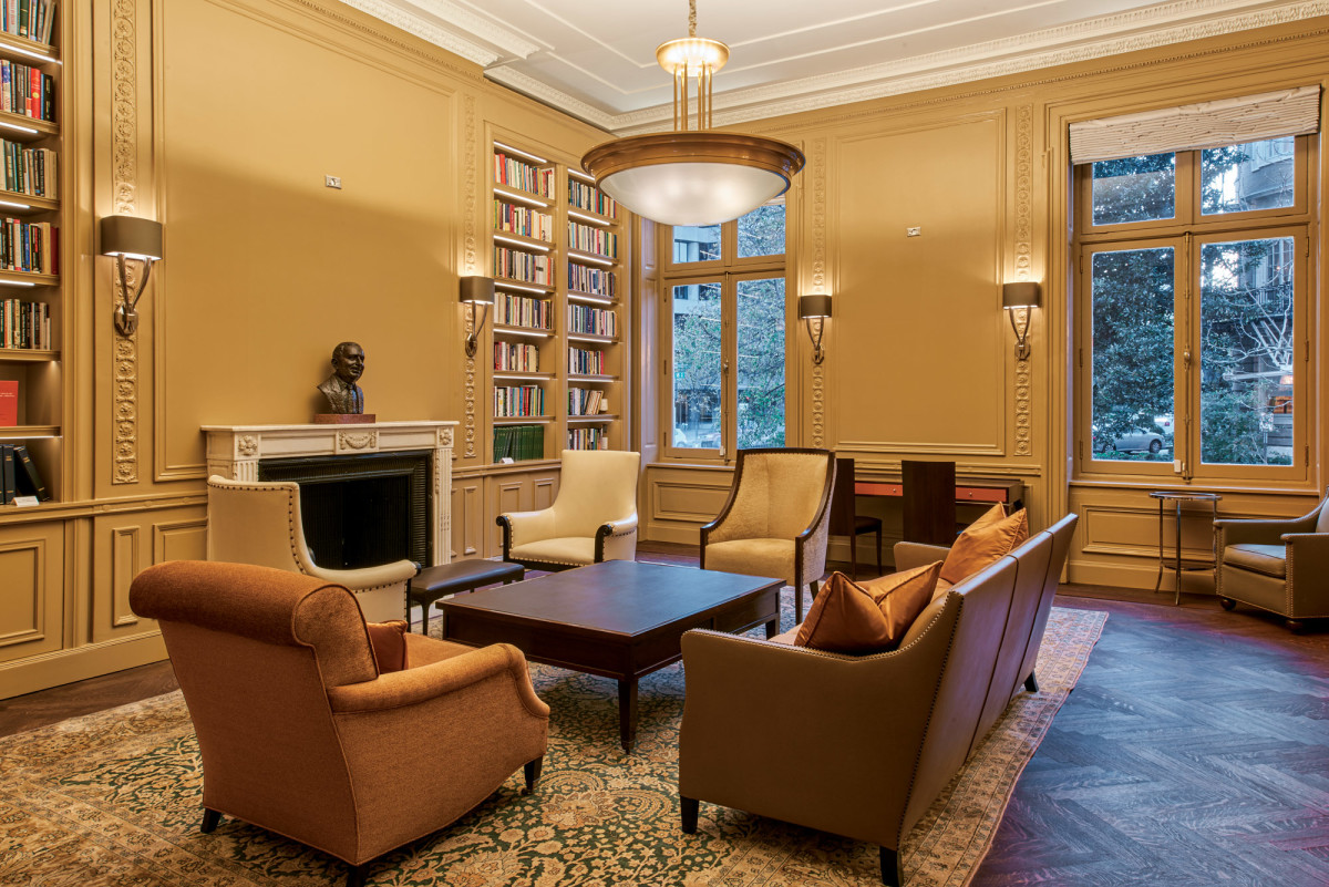 The team added built-in bookcases flanking the fireplace in the library.