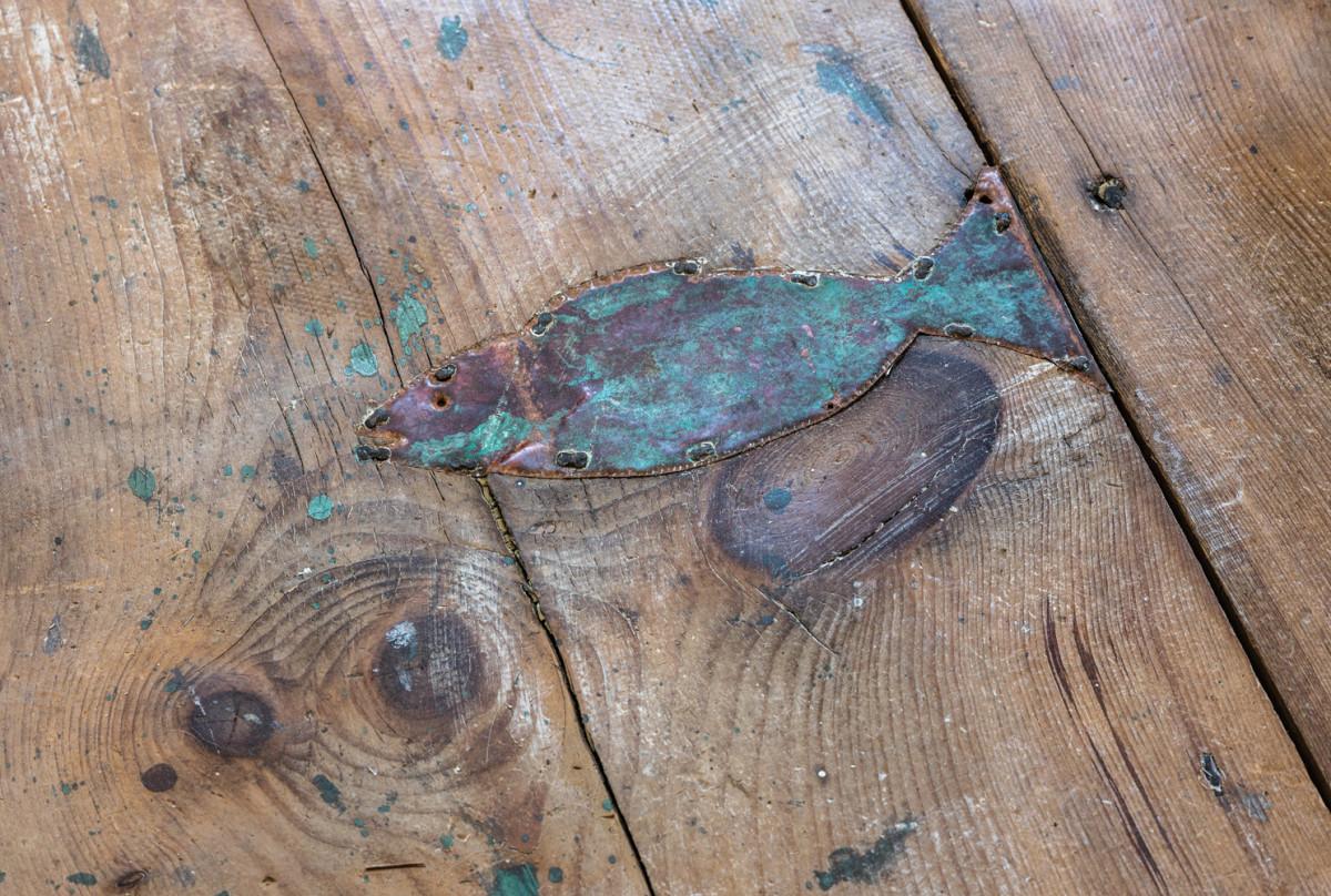 Antique flooring, fish in floor