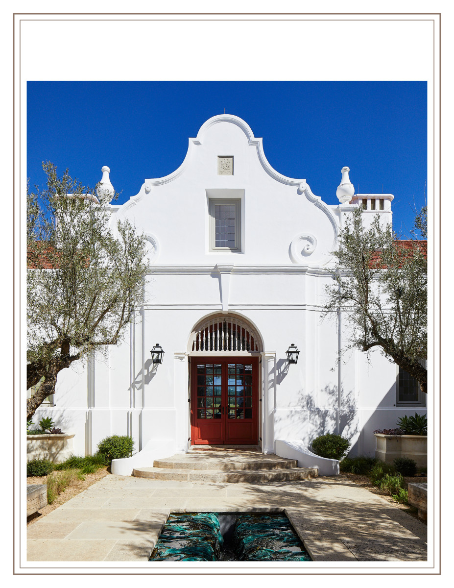 The entry to the ranch house has a façade inspired by the Alamo.